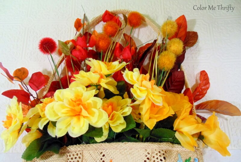 filling in purse with fall floals for fall door decor