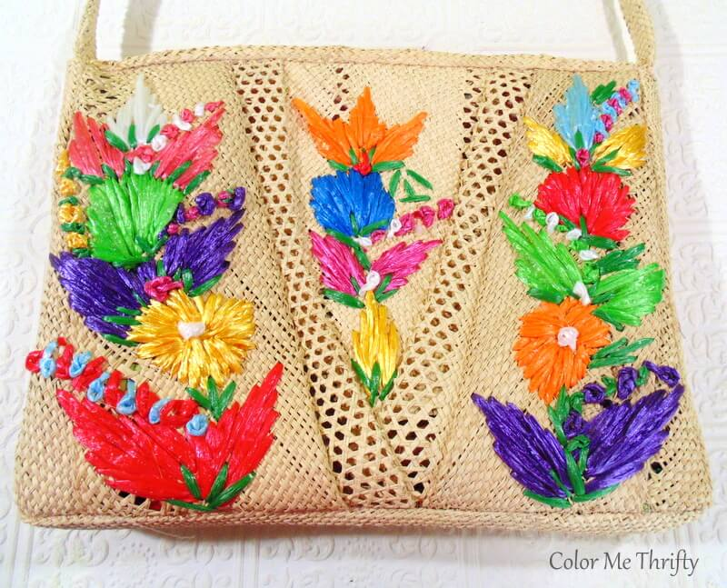 front of floral straw purse used to fall door decor
