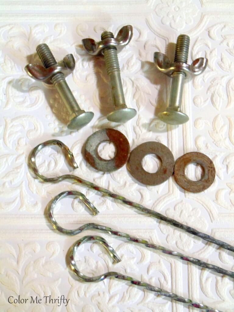 nuts and bolts and skewers used for repurposed wheel flowers