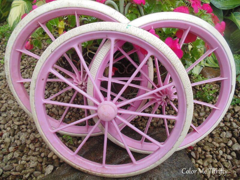 pink plastic doll carriage wheels used for repurposed wheel flowers