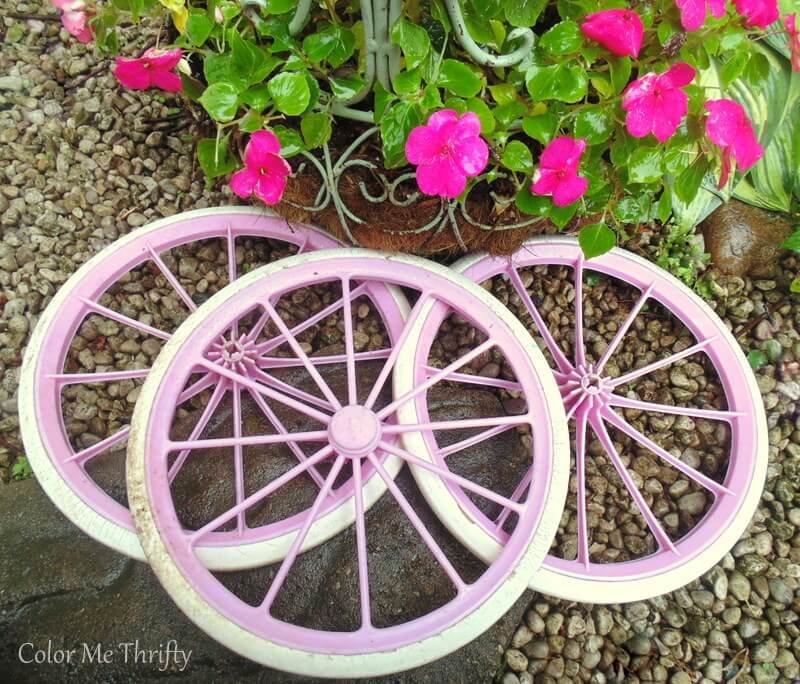 pink plastic wheels removed from doll carriage