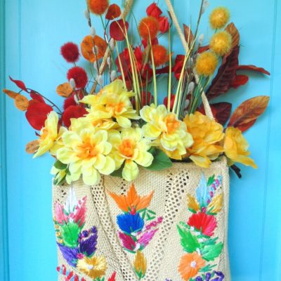 repurposed straw purse fall door decor