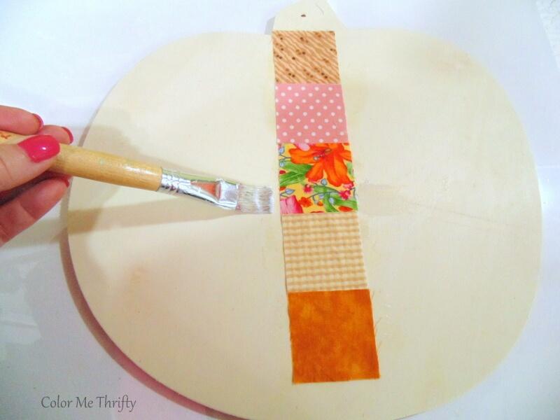 adding more fabric quilt blocks onto wooden pumpkim