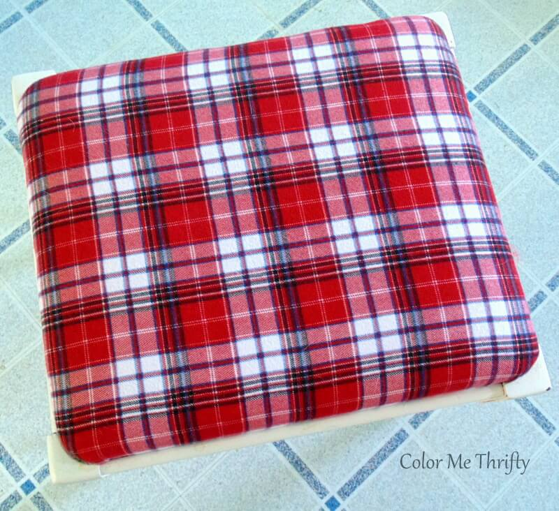 repurposed plaid shirt used for recovering a bench seat
