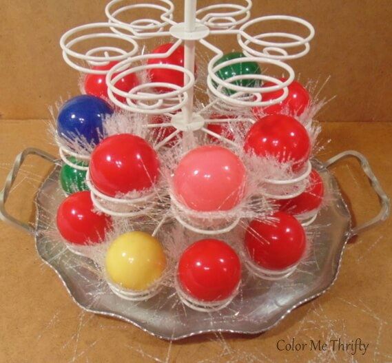 adding garland pieces and snooker balls onto other tiers of cupcake holder