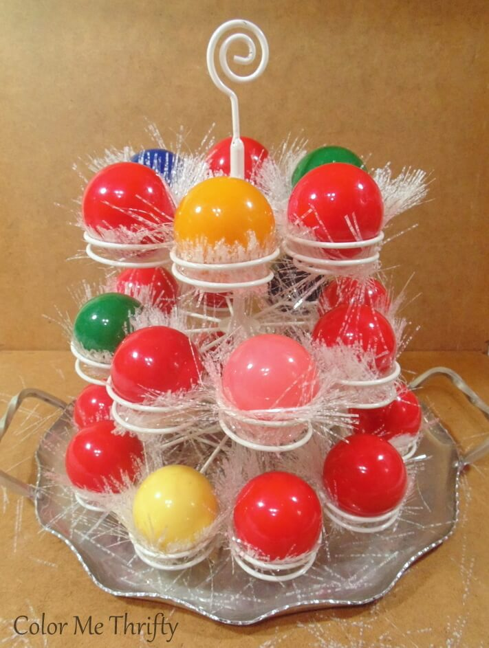 all three tiers of repurposed cupcake holder tree with added garland and snooker bakks
