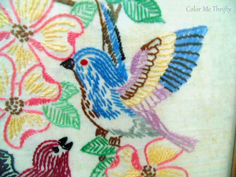 colorful blue bird with pin flowers needlework