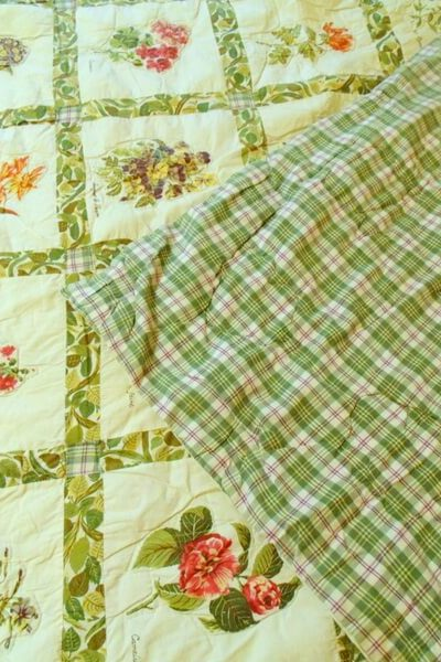 green and red plaid backing of handmade floral quilt