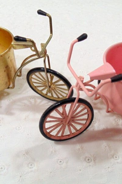 pair of decorative miniature tricycles