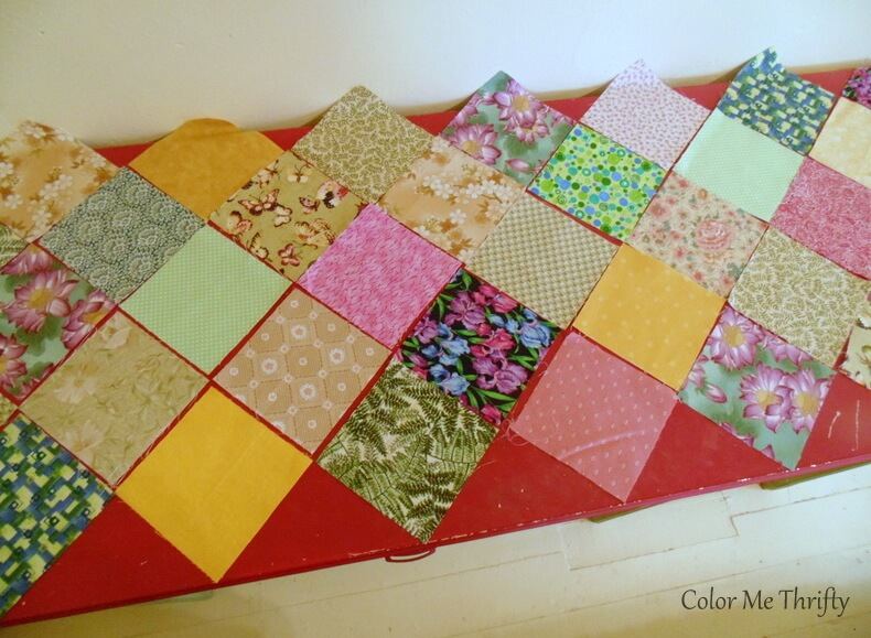 placing 4 inch quilt squares on top of dresser to create pattern