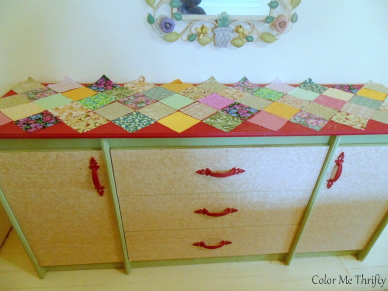 placing quilt squares on top of dresser to create pattern