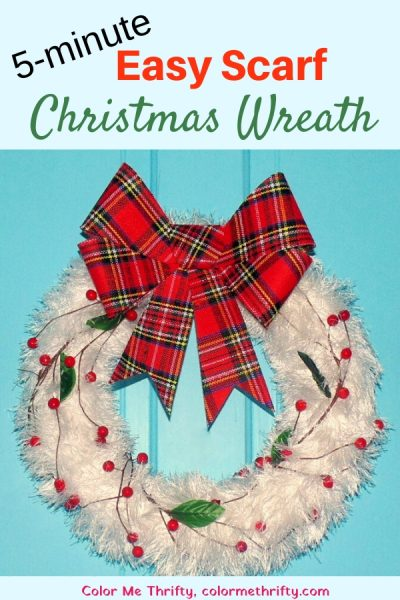 repurposed-fluffy-white-scarf-Christmas-wreath-with-faux-cranberry garland and plaid bow