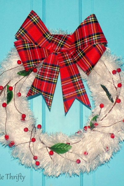 repurposed fluffy white scarf Christmas wreath with plaid bow and faux cranberries