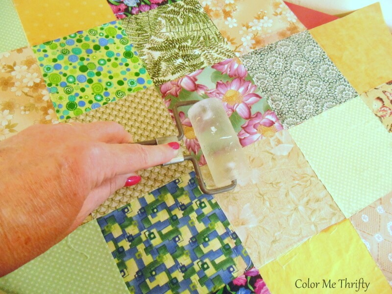 using a breyer to smooth down fabric quilt squares on dresser top