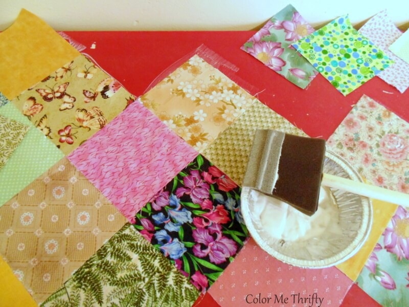 using decoupage medium and foam brush to apply quilt squares on to dresser 2