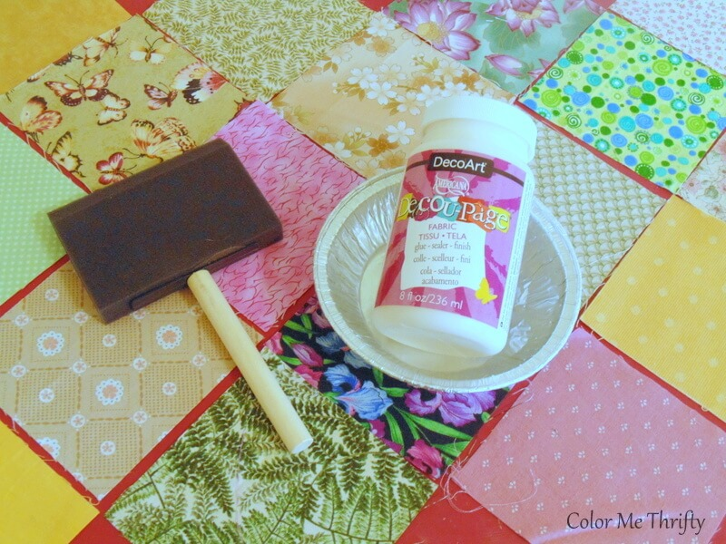 using decoupage medium and foam brush to apply quilt squares on to dresser