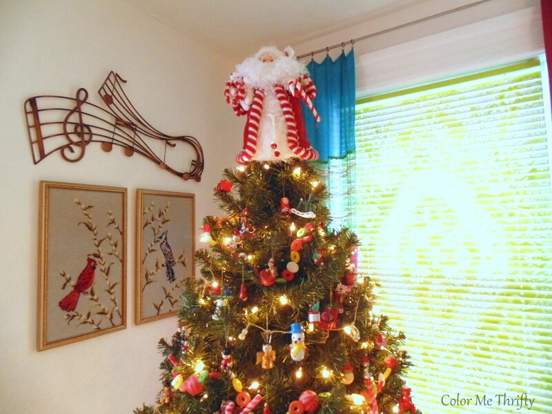 Christmas tree decorated with hand painted vintage wooden ornaments