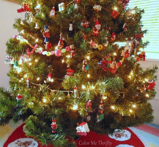 Christmas tree decorated with vintage hand painted wooden ornaments