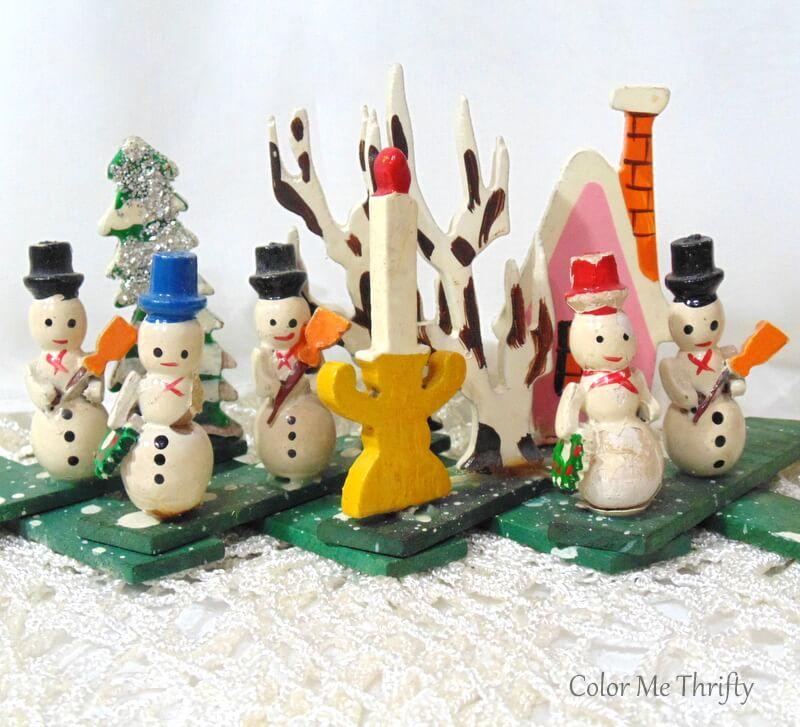 Vintage wooden miniature snowman scene