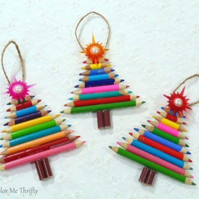 adding jute twine to pencil crayon tree ornaments for hanging on the tree