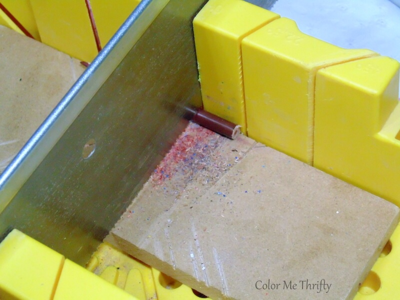 cutting pencil crayons with miter box and saw for tree ornaments