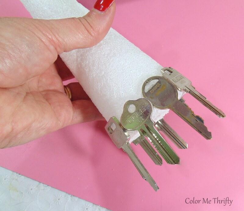 gluing keys onto bottom of 8 inch styrofoam cone