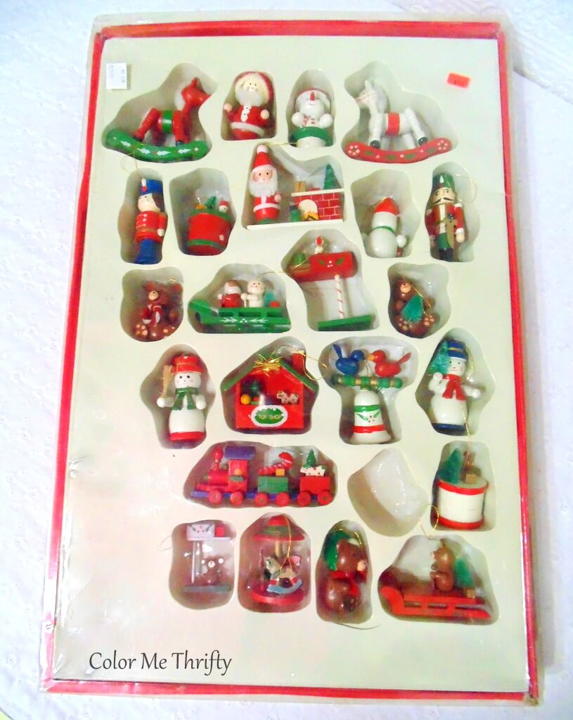 large box of large hand painted wooden ornaments