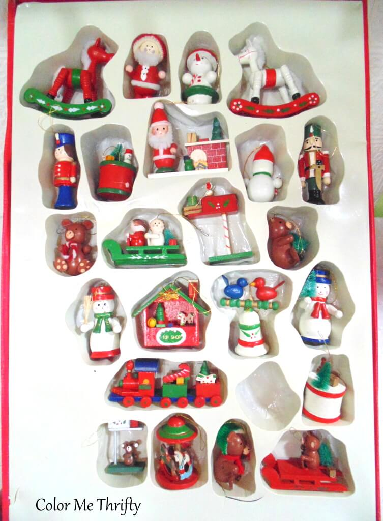large box of large hand painted wooden ornaments without plastic cover on