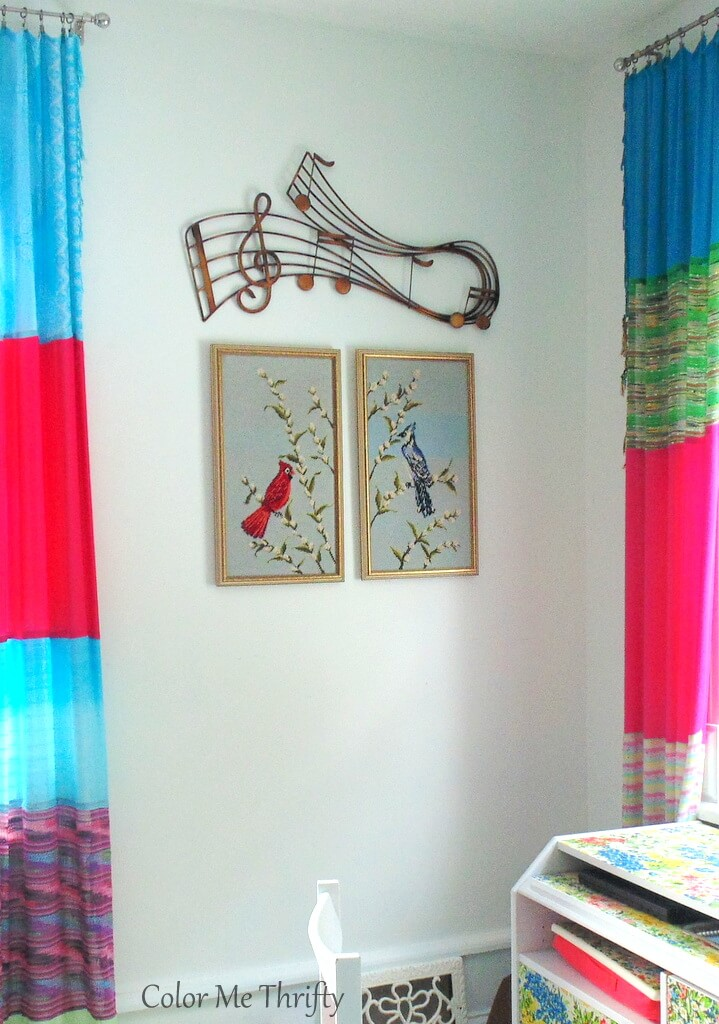living room wall vignette with bird needlepoint pictures and large musical note wall decor
