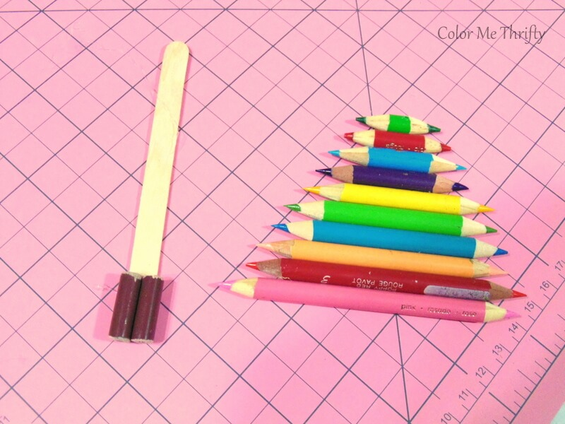 using popsicle stick as back of diy tree ornaments made from pencil crayons