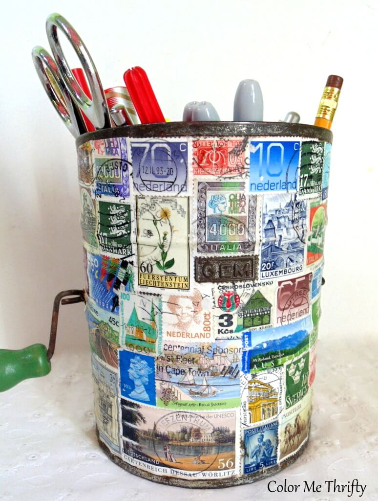 Decoupaged stamps on repurposed metal sifter diy pencil holder