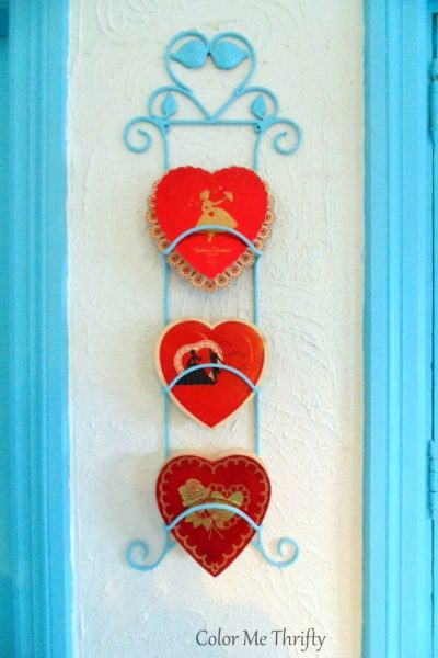 Displaying Valentine's Day chocolate boxes on aqua blue spray painted plate hanger
