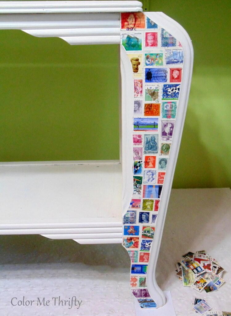 after of table legs decoupaged with postage stamps
