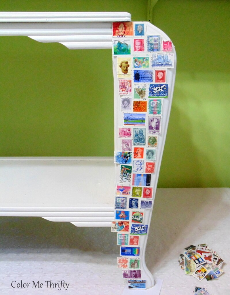 applying stamps to table legs with decoupage medium