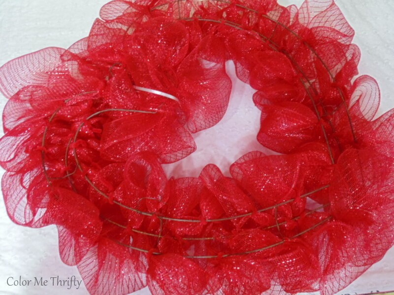 back of red mesh ribbon wreath