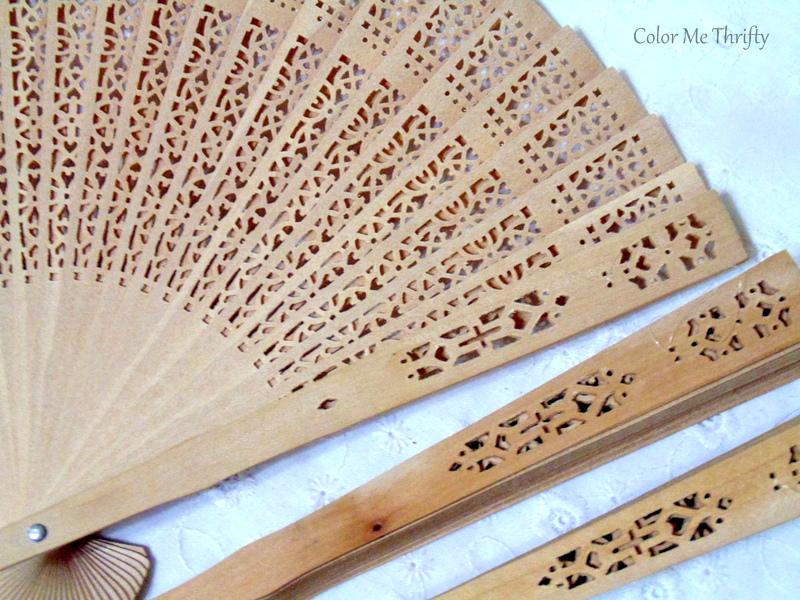 close up of carved sandalwood hand folding fans