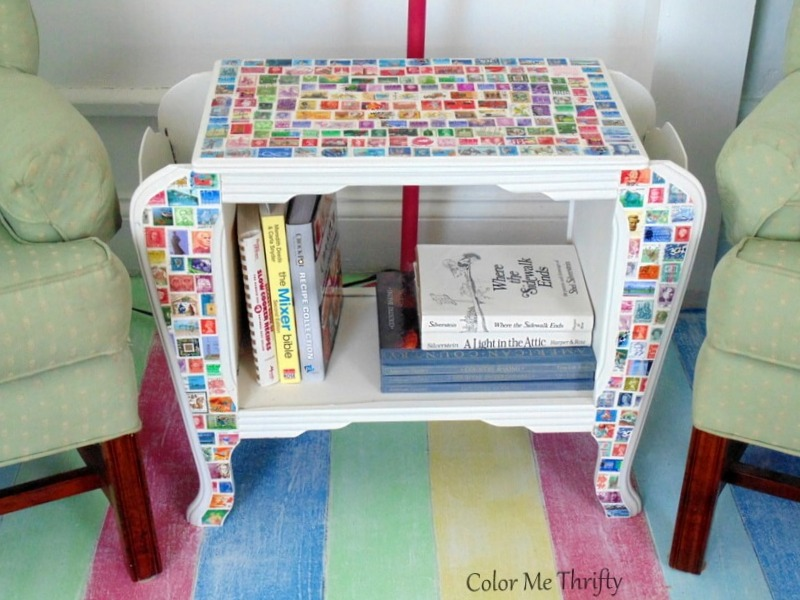 decoupaged stamp magazine table holding books