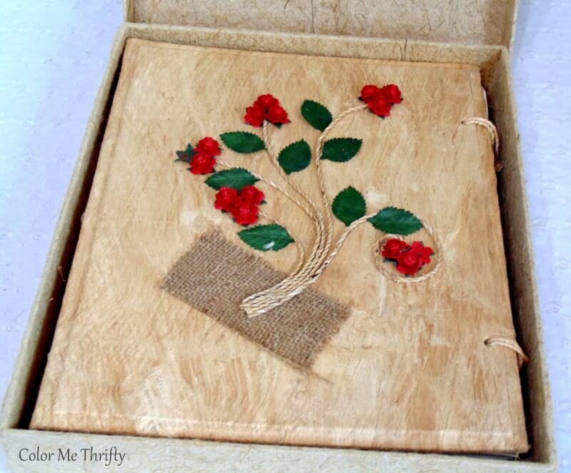 handmade paper photo album with red paper roses on cover