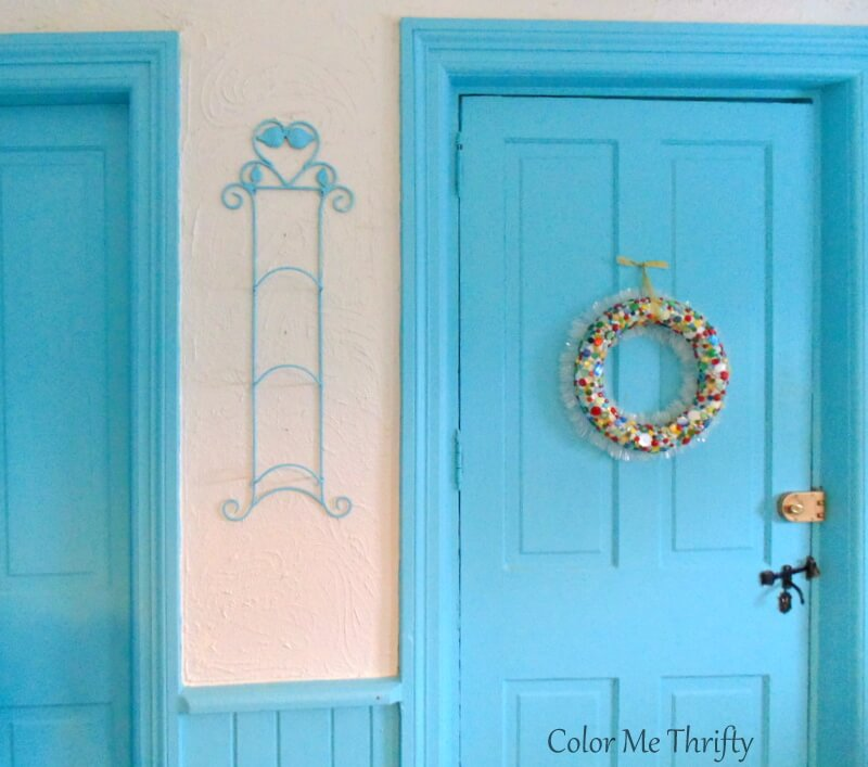 hanging aqua blue plate hanger in kitchen