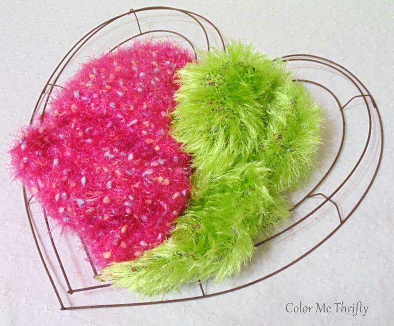 pink and green scarves and metal heart wreath frame