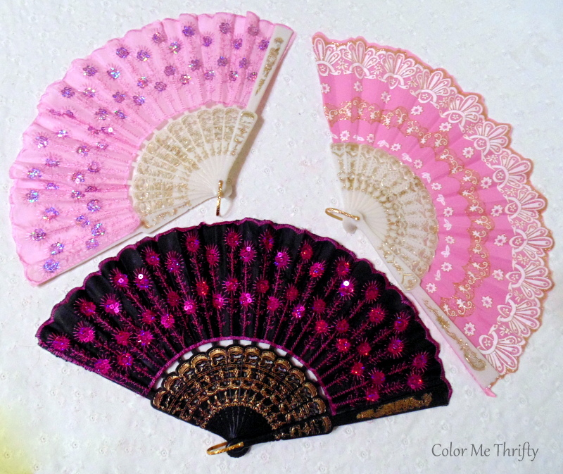 pink and purple fabric hand folding gans