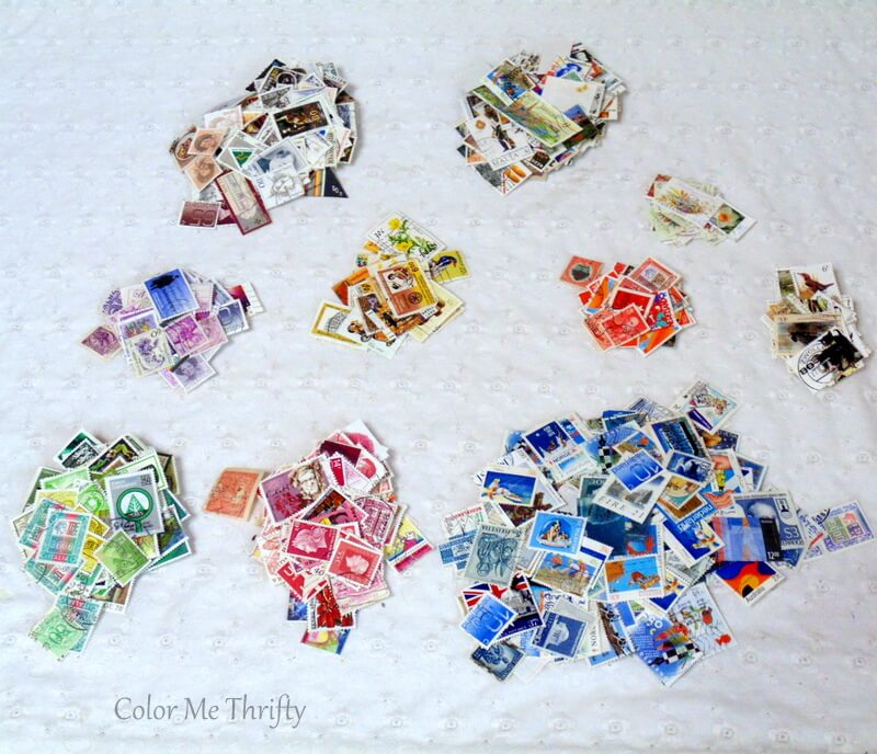 postage stamps separated by color for table makeover