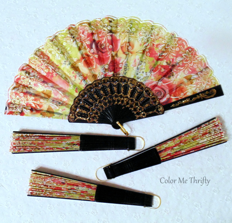 red floral and yellow fabric hand folding fans