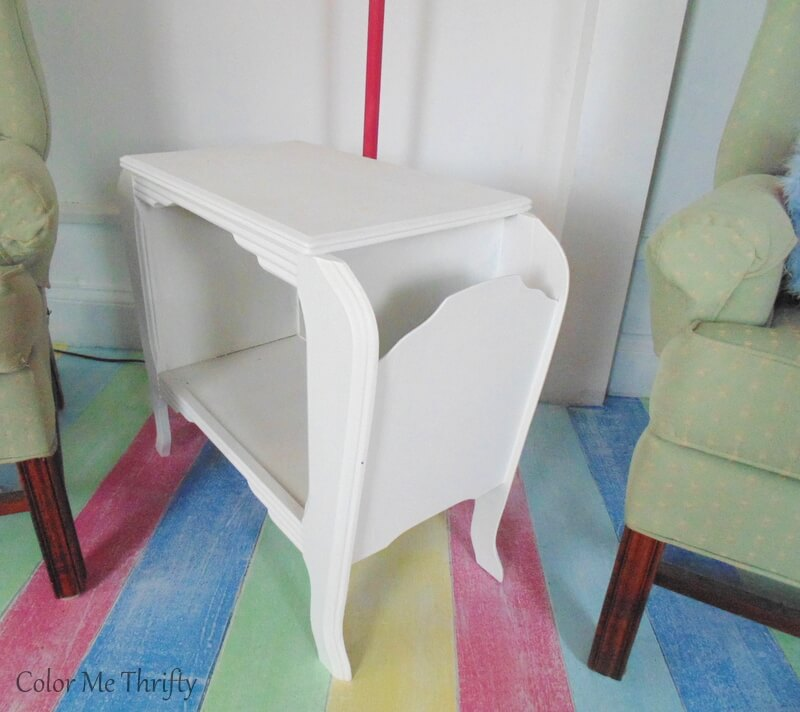 side view vintage wooden magazine end table painted white