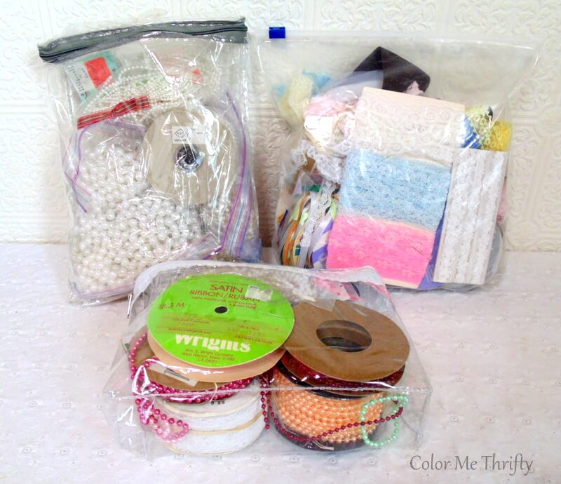 thrifted craft supplies including lace, beading, ribbons
