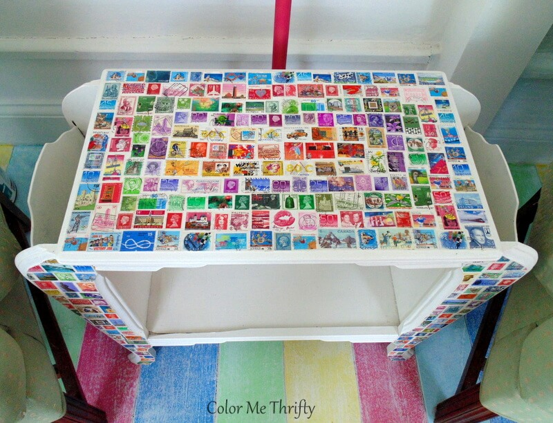 top of decoupaged postage stamp magazine table makeover