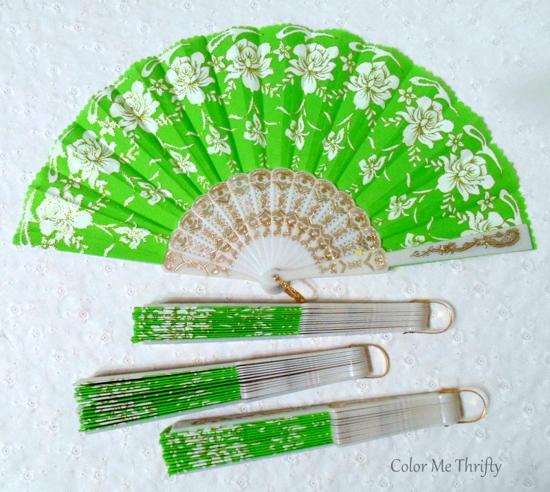 white floral and green fabric hand folding fans