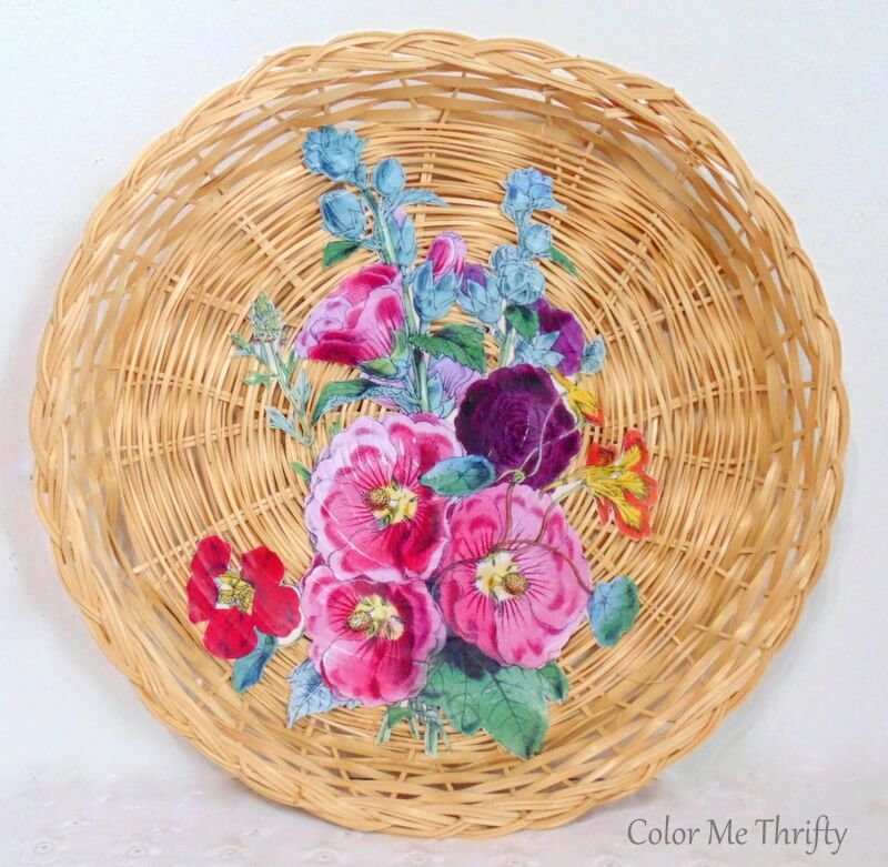 Decoupaged floral graphics on repurposed wicker plates