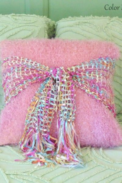 Repurposed pillow makeover with tied ribbon scarf in horizontal position