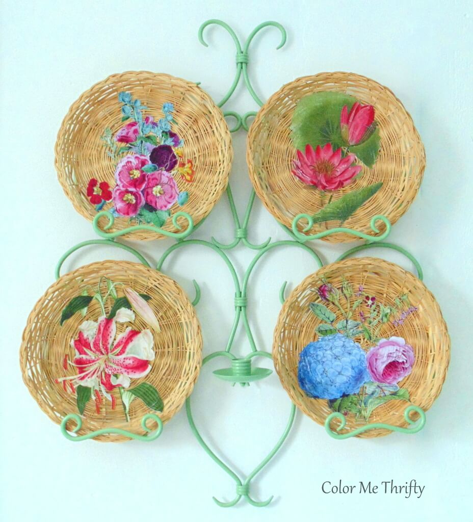 Repurposed wicker plates decoupaged with floral graphics and displayed in plate holder